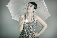 20s woman with white umbrella, pin up style Stock Photos