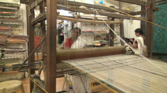 India Kerala woman weaving looks through strands  Stock Footage