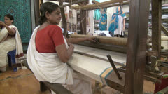 India Kerala woman seated operates handloom  Stock Footage