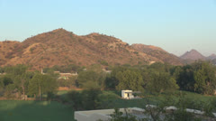India Rajasthan Udaipur hill and pasture with white house 45 Stock Footage