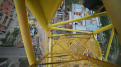 View of the construction site down the crane. Crane rotating axis Stock Footage