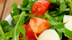 Vegetable food : green salad with raw tomato Stock Footage