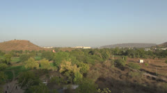 India Rajasthan Udaipur City Palace over forest long shot 34 Stock Footage