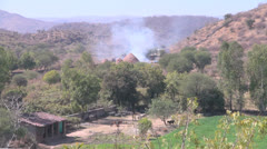 India Rajasthan Udaipur smoky kiln mounds and barnyard 15a Stock Footage