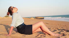 Pretty businesswoman relaxing on beautiful beach HD Stock Footage