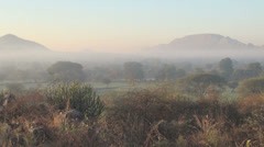 India Rajasthan Udaipur countryside tinted mist between hills 41 Stock Footage