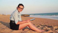 Happy businesswoman with tablet computer on the beach HD Stock Footage
