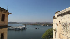 India Rajasthan Udaipur Lake Palace from between buildings 22 Stock Footage