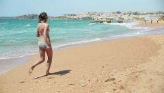 Happy, excited woman running on the beach HD Stock Footage