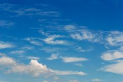 Blue sky and white billows Stock Photos