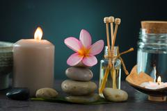 Tropical frangipani spa health treatment with aroma therapy and hot stones, s Stock Photos