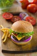 Burger with fast food items and materials on the background Stock Photos