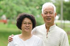 Chinese asian senior couple at outdoor Stock Photos