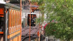 Low angle shot of funicular tram and cable car, transporting people. Stock Footage