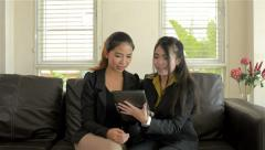 young asian businesswomen discussing work on a tablet pc - stock footage