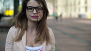 Sad, depressed young beautiful woman in the city HD Stock Footage