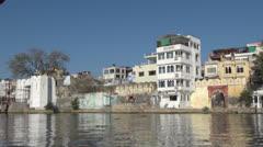 India Rajasthan Udaipur lakeside buildings and bridge pan 26 Stock Footage