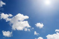 sun with clouds - stock photo