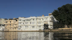 India Rajasthan Udaipur City Palace passes in view from lake 15 Stock Footage