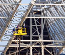 workers build roof of stadium - stock photo