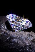 Diamond on coal Stock Photos