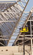 welder workers build roof stadium - stock photo