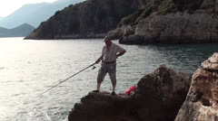 Fishing from a cliff Stock Footage