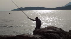Man fishing at the sunset Stock Footage