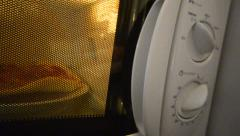 Cooking using a microwave oven. pizza is preparation close up macro dolly mov Stock Footage