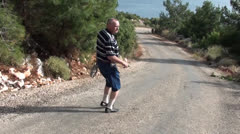 Man walks downhill turning back Stock Footage