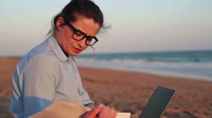 Businesswoman working with documents and laptop on the beach HD Stock Footage