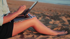 Businesswoman working on tablet computer on the beach HD Stock Footage
