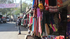 India Rajasthan Udaipur browsing colorful cloths in street booth 28 - stock footage