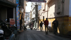 India Rajasthan Udaipur shadowy narrow street and motorcycles 13 Stock Footage