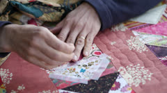 Close Up of Woman Sewing A Quilt Stock Footage
