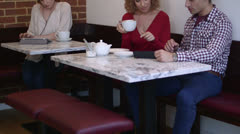 Man and women sitting in cafe Stock Footage