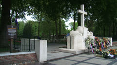 Flowers at Monument with Cross of Remembrance - pan Stock Footage