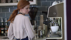 Woman working in cafe Stock Footage