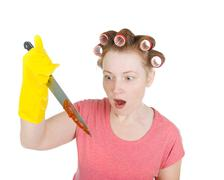 Stock Photo of aggressive housewife  with bloodstained  knife.