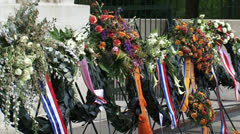 Flowers at Monument with Cross of Remembrance  - close up Stock Footage