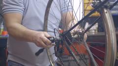 Man repairing bicycle in workshop Stock Footage