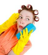 crazy housewife  maid cleaner with sponge - stock photo