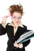 Stock Photo of stressed crazy businesswoman with  stack of paperwork.