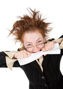 crazy businesswoman breaks contract - stock photo