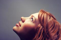 fashion portrait of a red hair sexy woman - stock photo