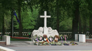 Stock Video Footage of Monument with Cross of Remembrance - Military War Cemetery