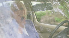 Senior Woman doing make-up in car Stock Footage