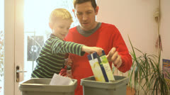 Father and son sorting recyclable materials Stock Footage