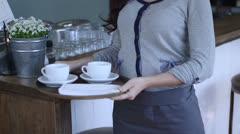 Waitress holding tray Stock Footage