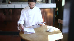 Man using tablet, small business, chef Stock Footage